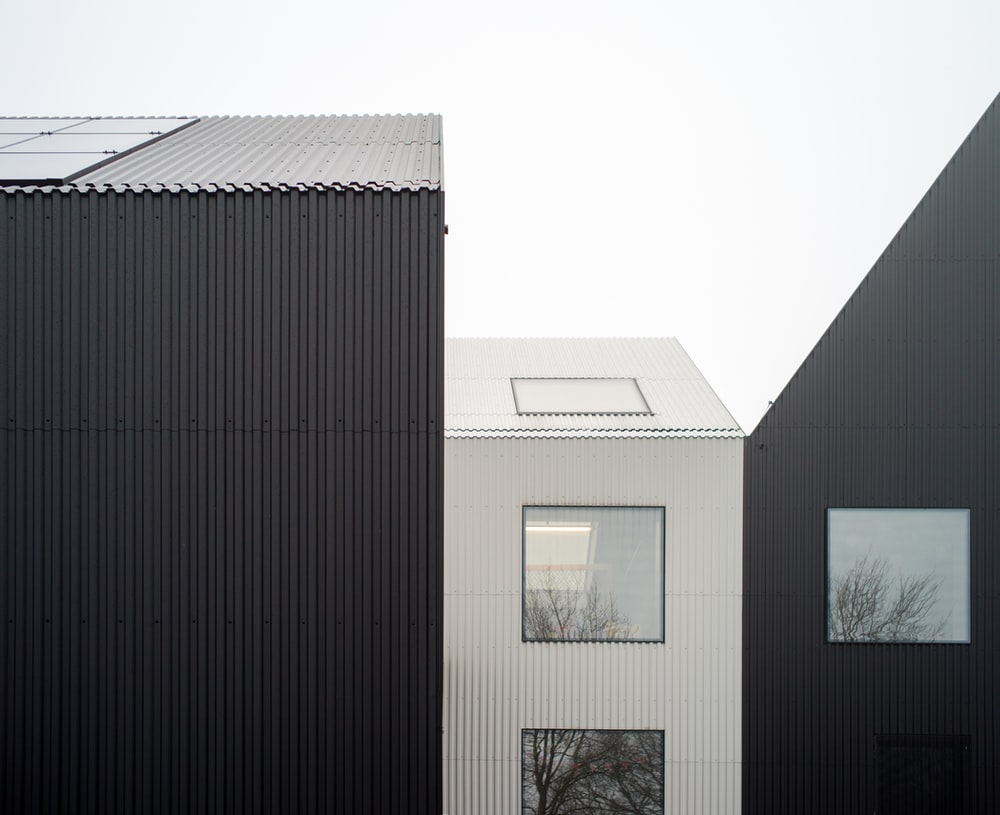 white and black house with clear full-glass window