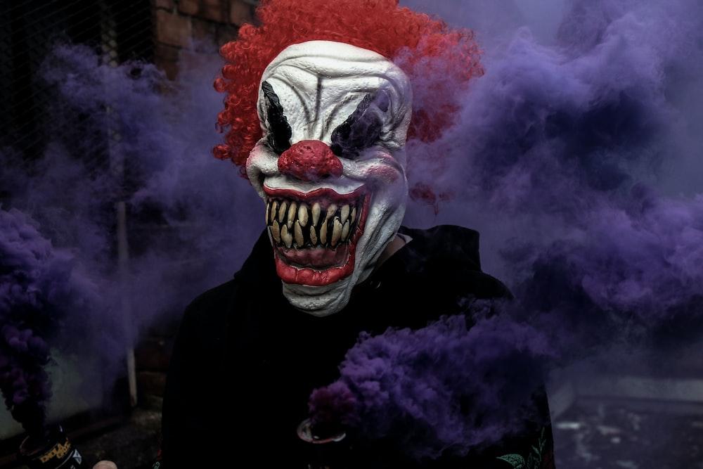 monster clown surrounding fog