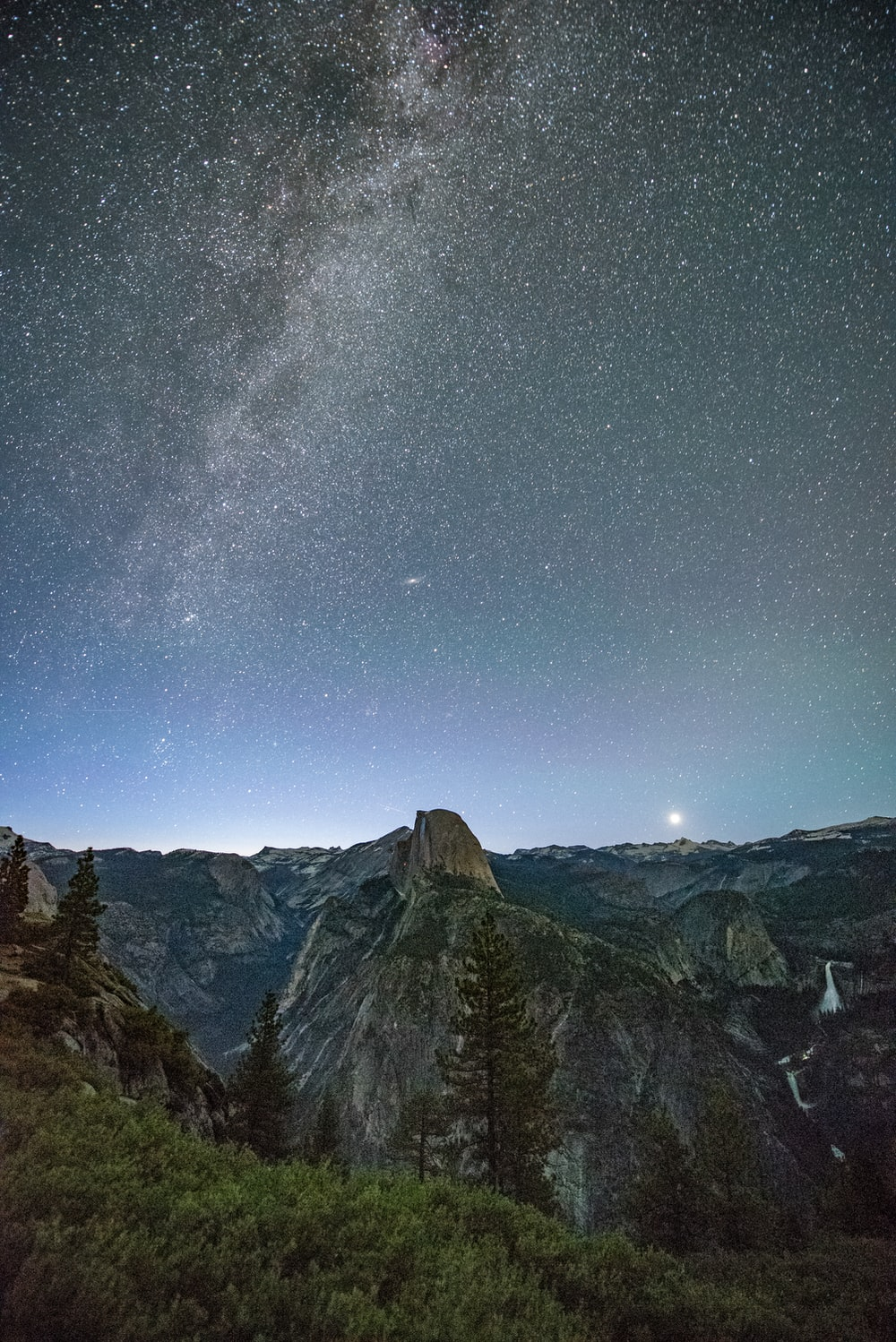 gray mountains under starry night