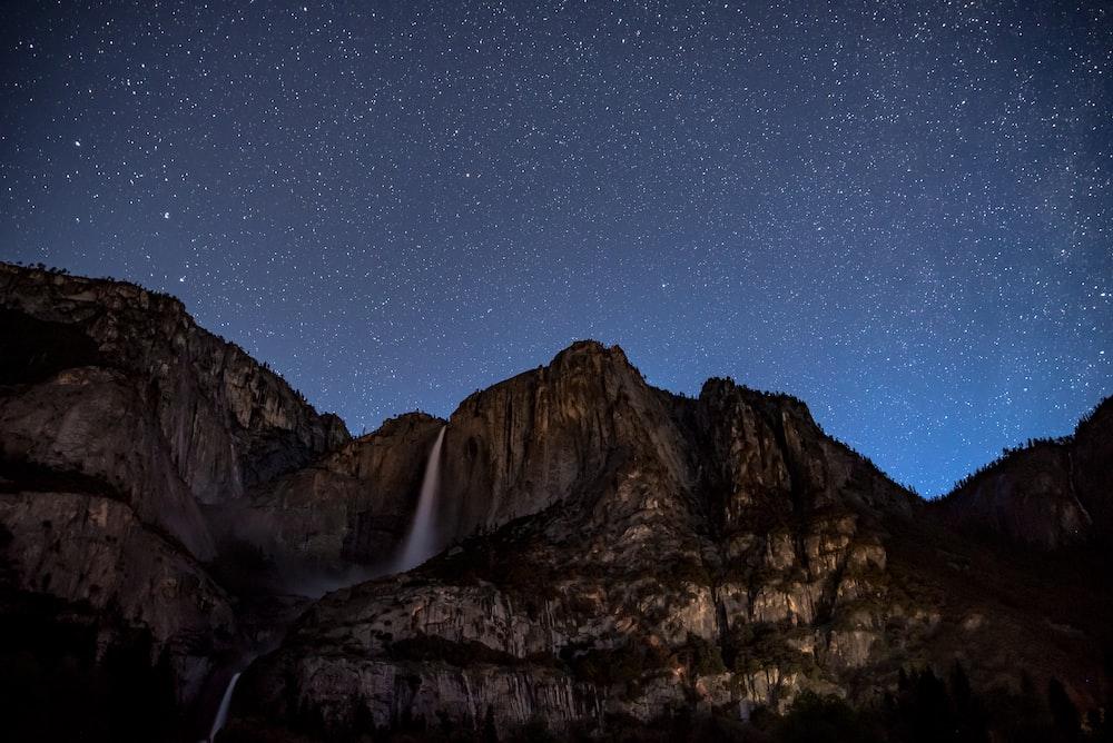 waterfalls on rock cliff