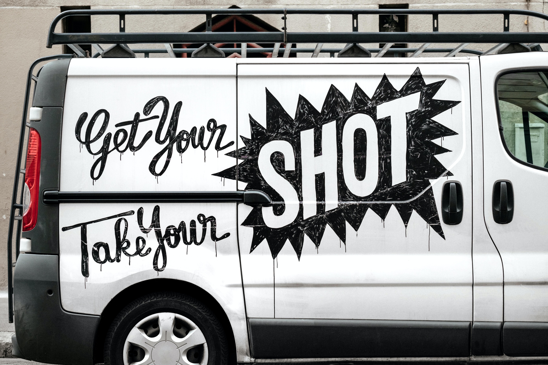 Advertisement messages on a white van in Paris.