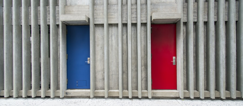 two blue and red door closed during daytime