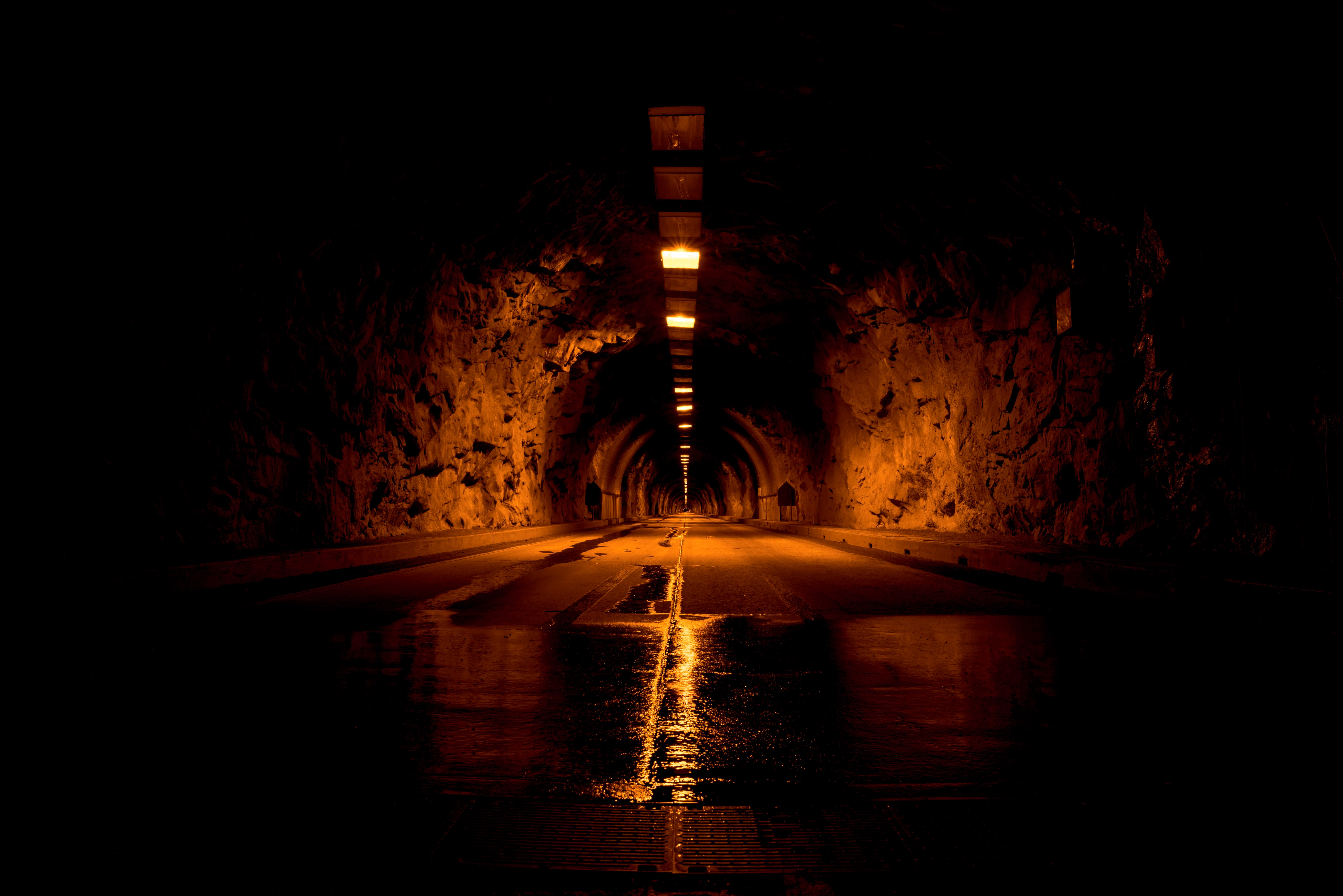 brown tunnel with lights