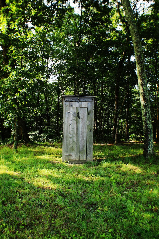 gray wooden outdoor portable bathroom