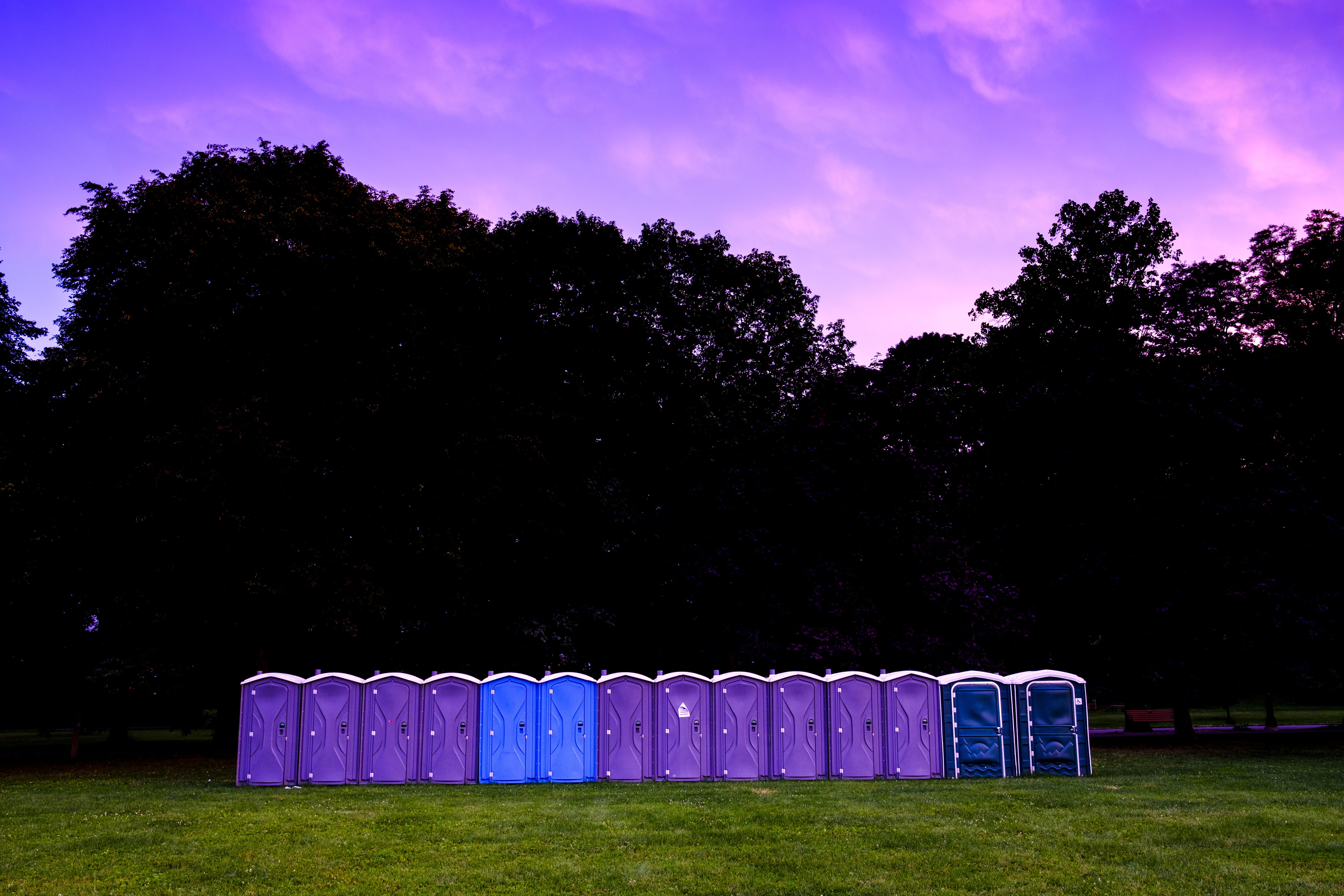 photography of portable toilet on field