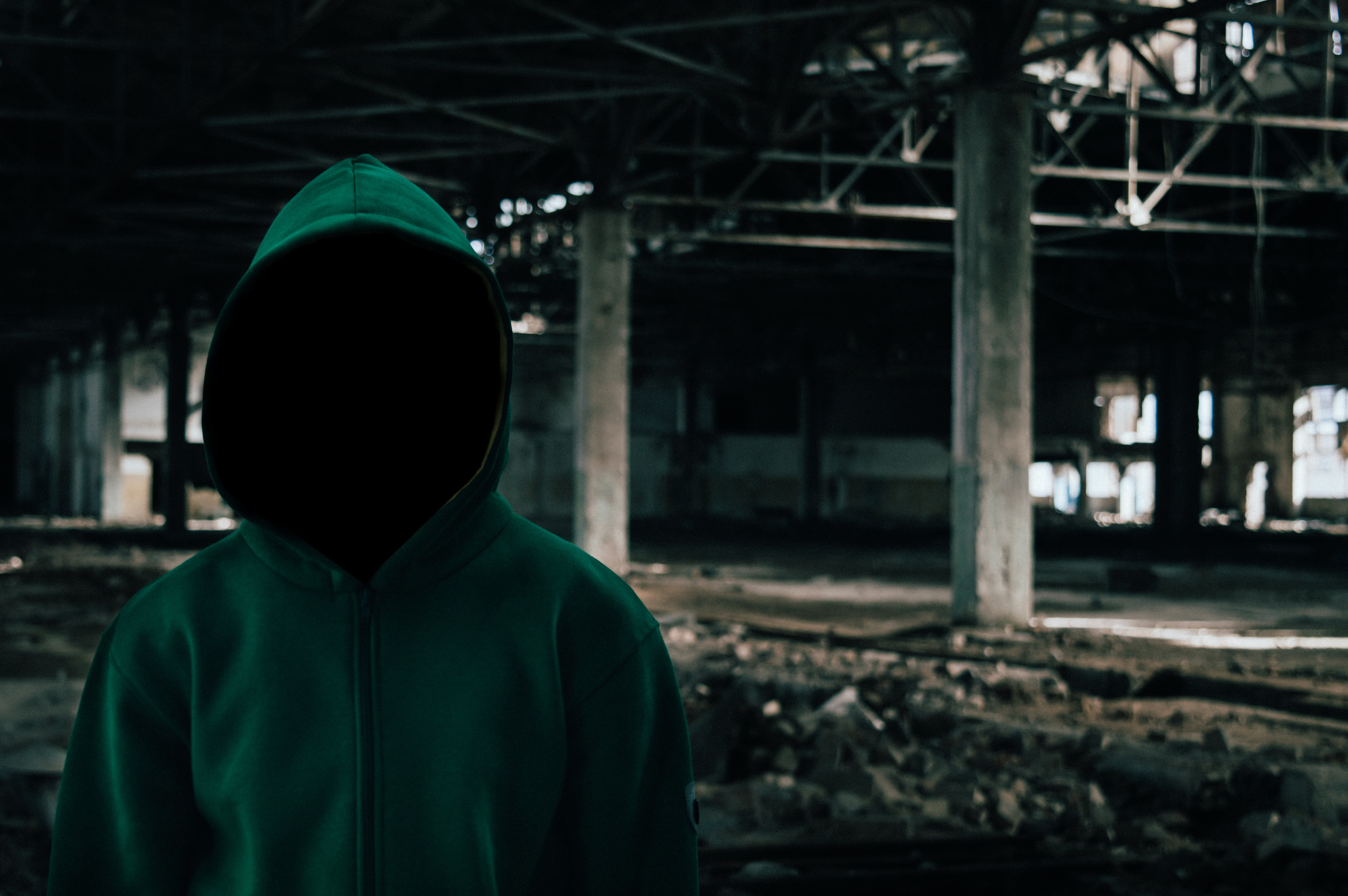 person wearing green hooded jacket