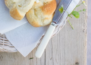 cooked bread on wicker plate on table