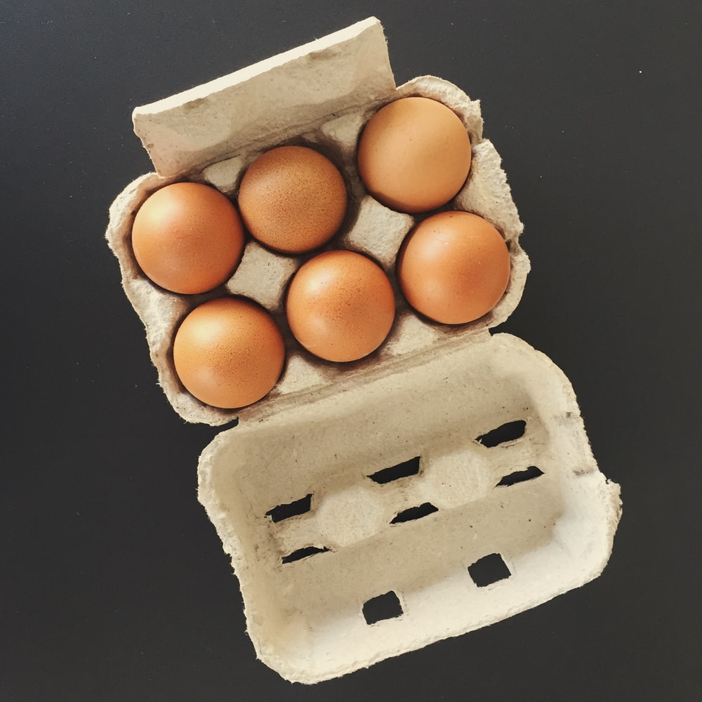 six brown fowl eggs in tray