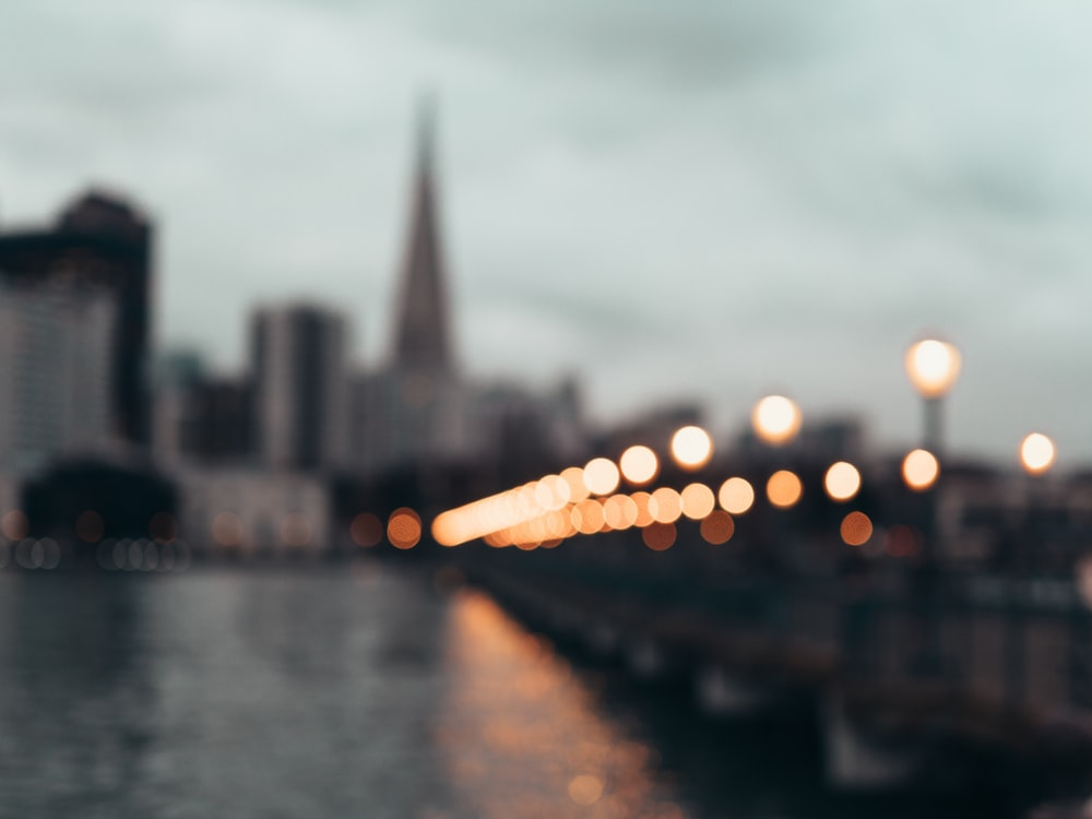 bokeh photography of bridge with light posts