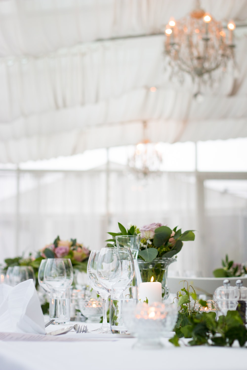 clear long-stem wine glasses on table