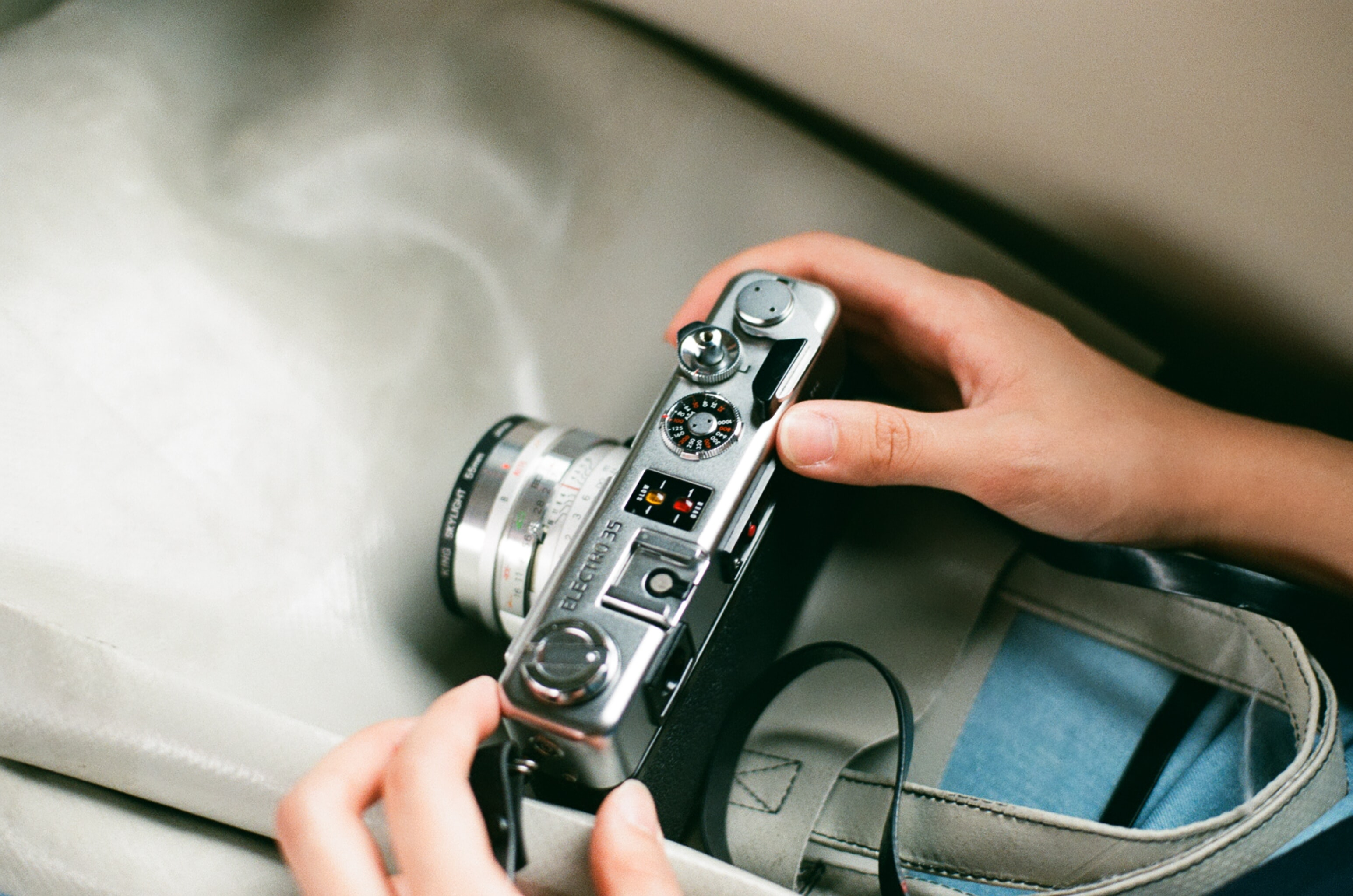 person holding gray and black DSLR camera