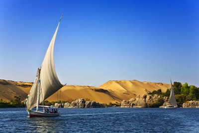 white sailboat on water under blue cloudy sky during daytime photo egypt zoom background