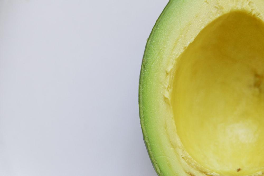 sliced avocado against white background