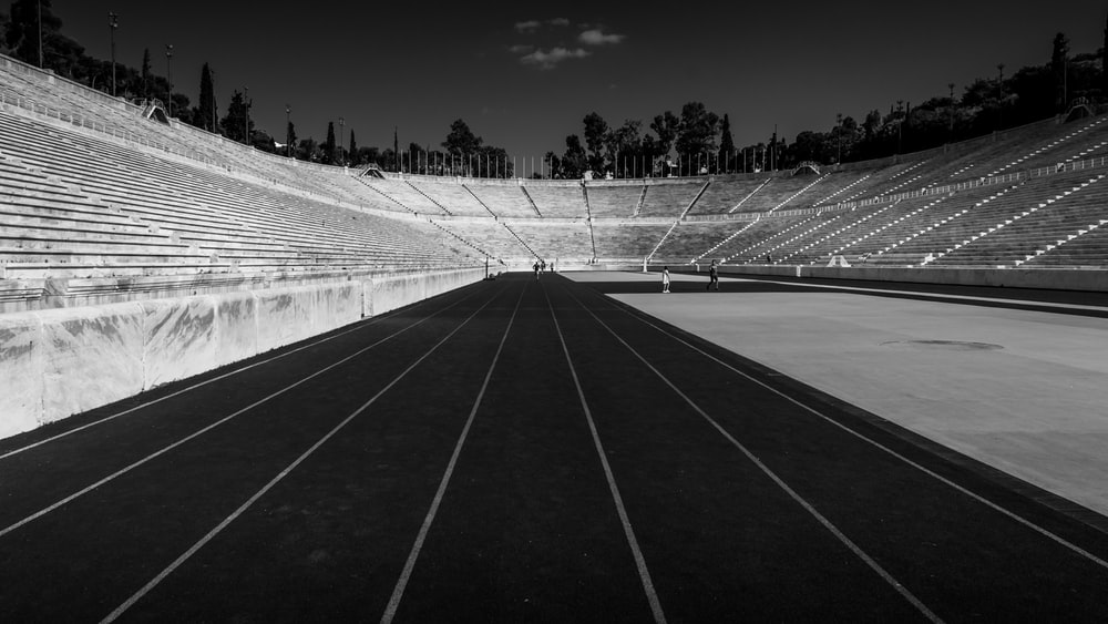 grayscale of stadium at night