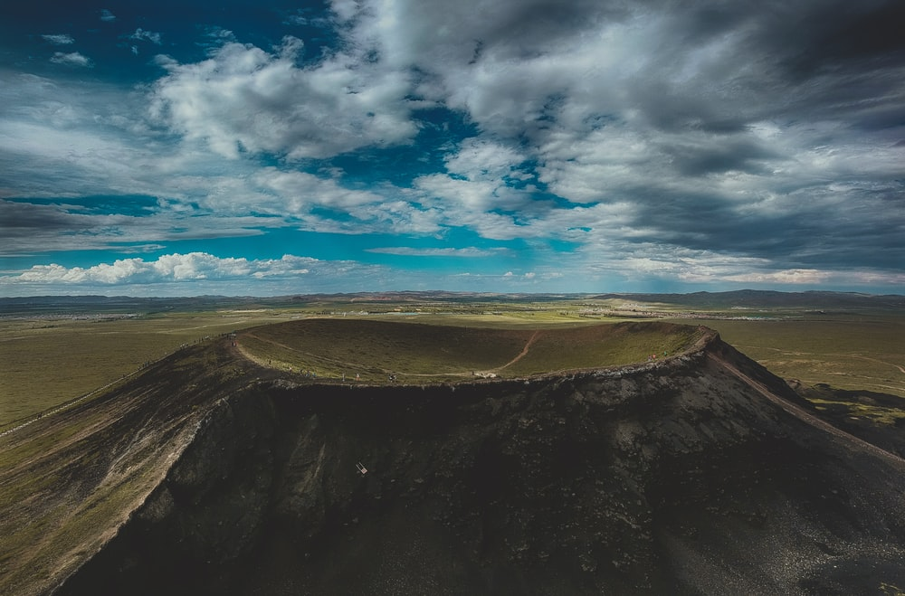 crater under blue cloudy sky during daytime