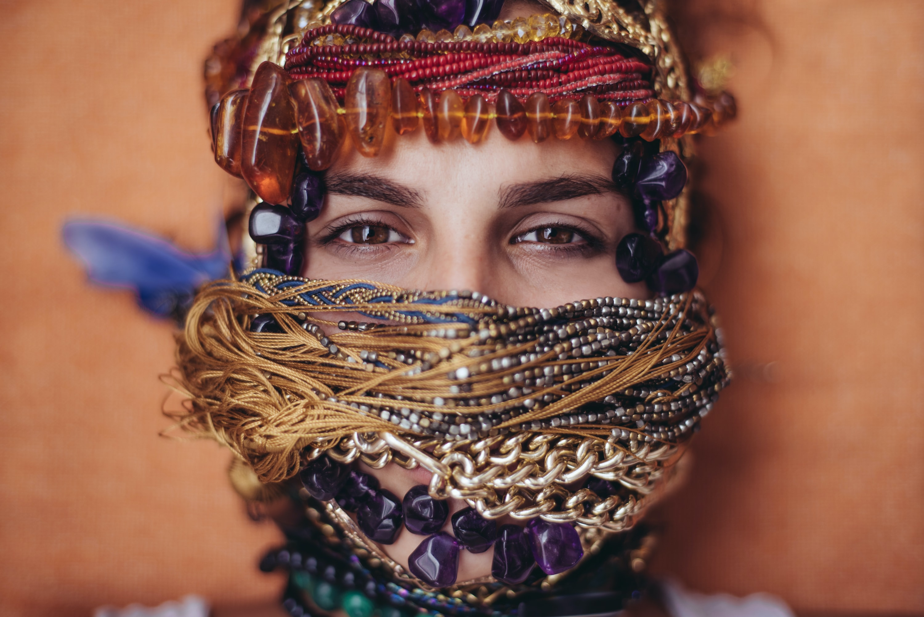 shallow focus photography of woman covered of accessories