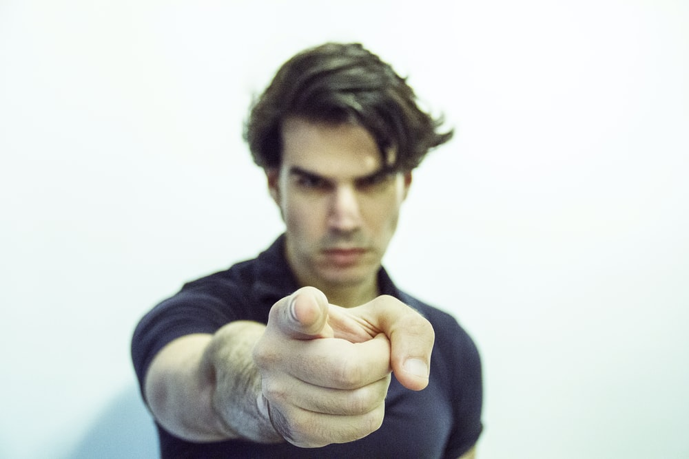 man pointing at camera