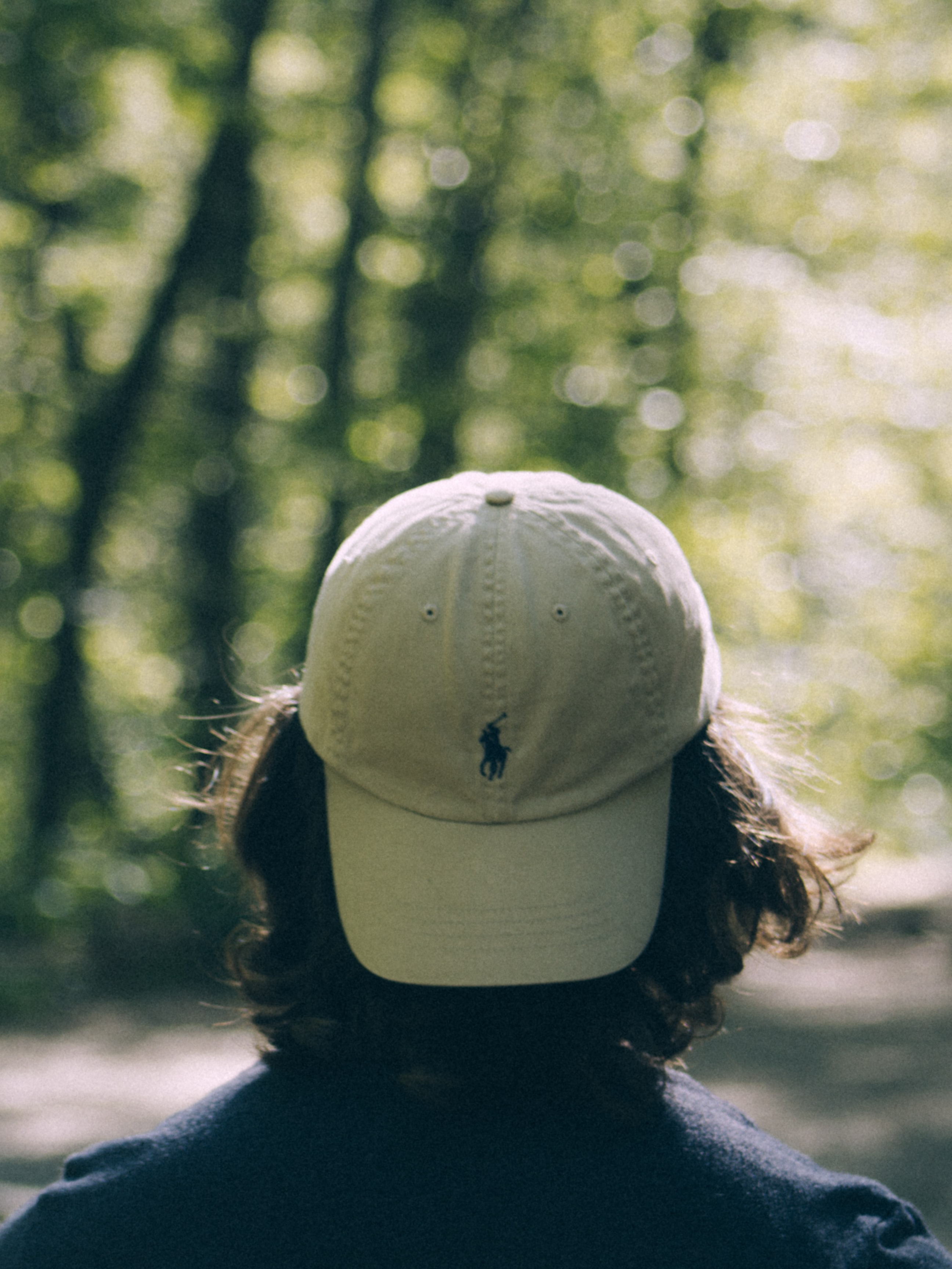 person wearing white Ralph Lauren fitted cap