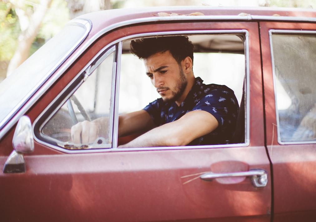 Man looking pensive in car