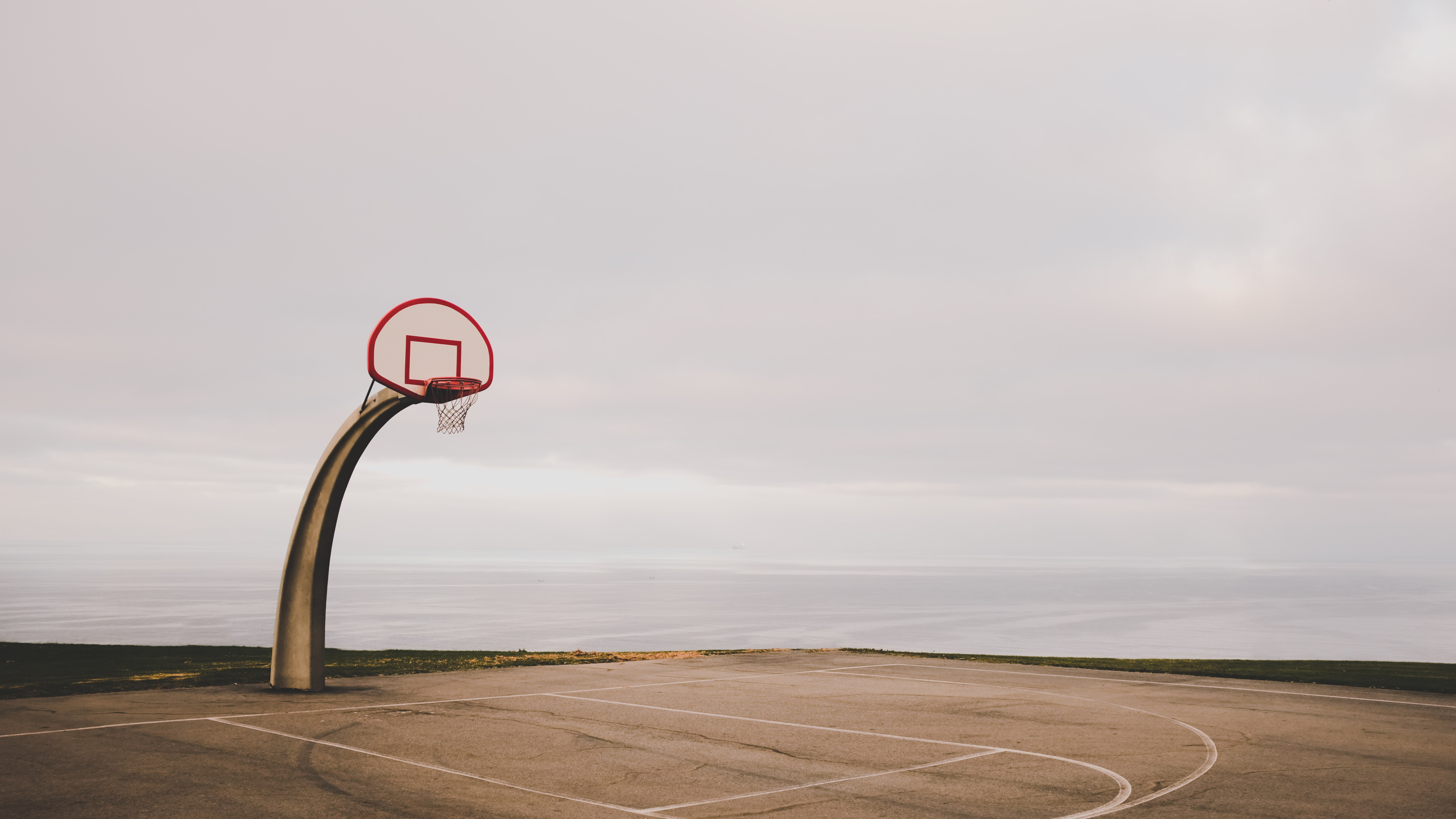 basketball court near body of water
