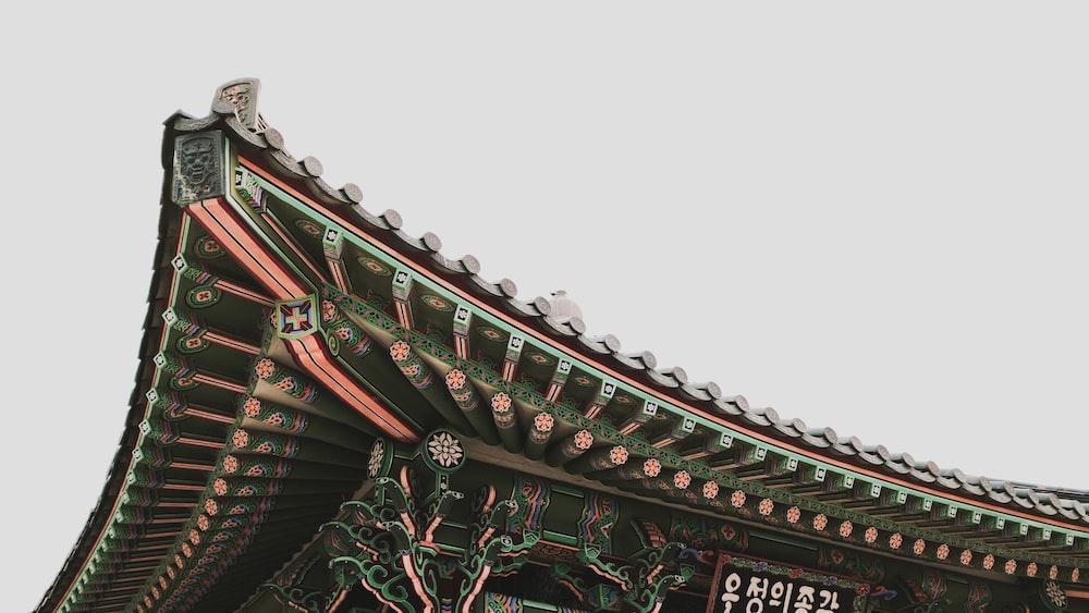 low-angle photography of black pagoda