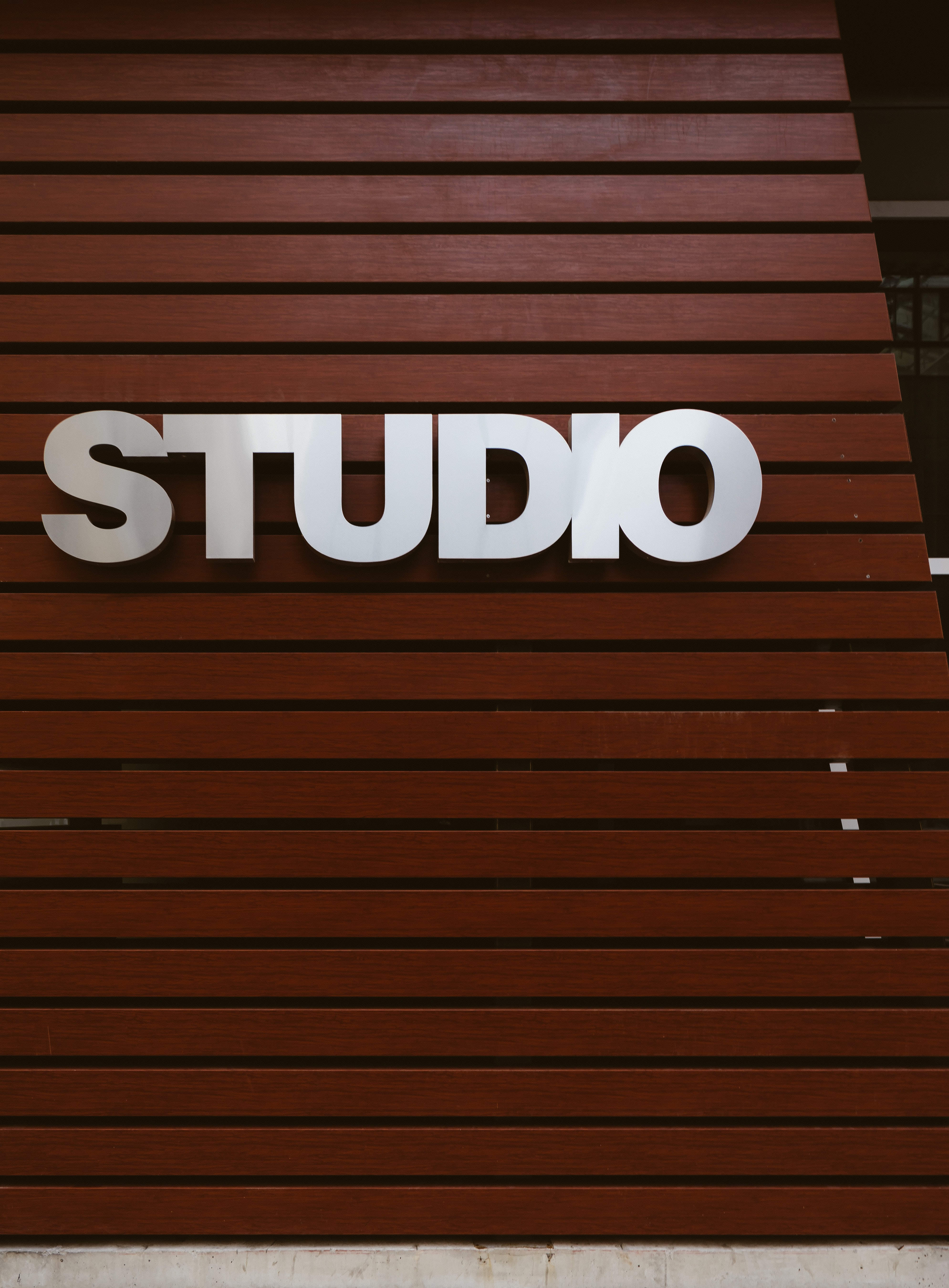 Studio, written on a sign on a wall.