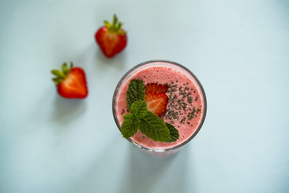 strawberry juice on white surface