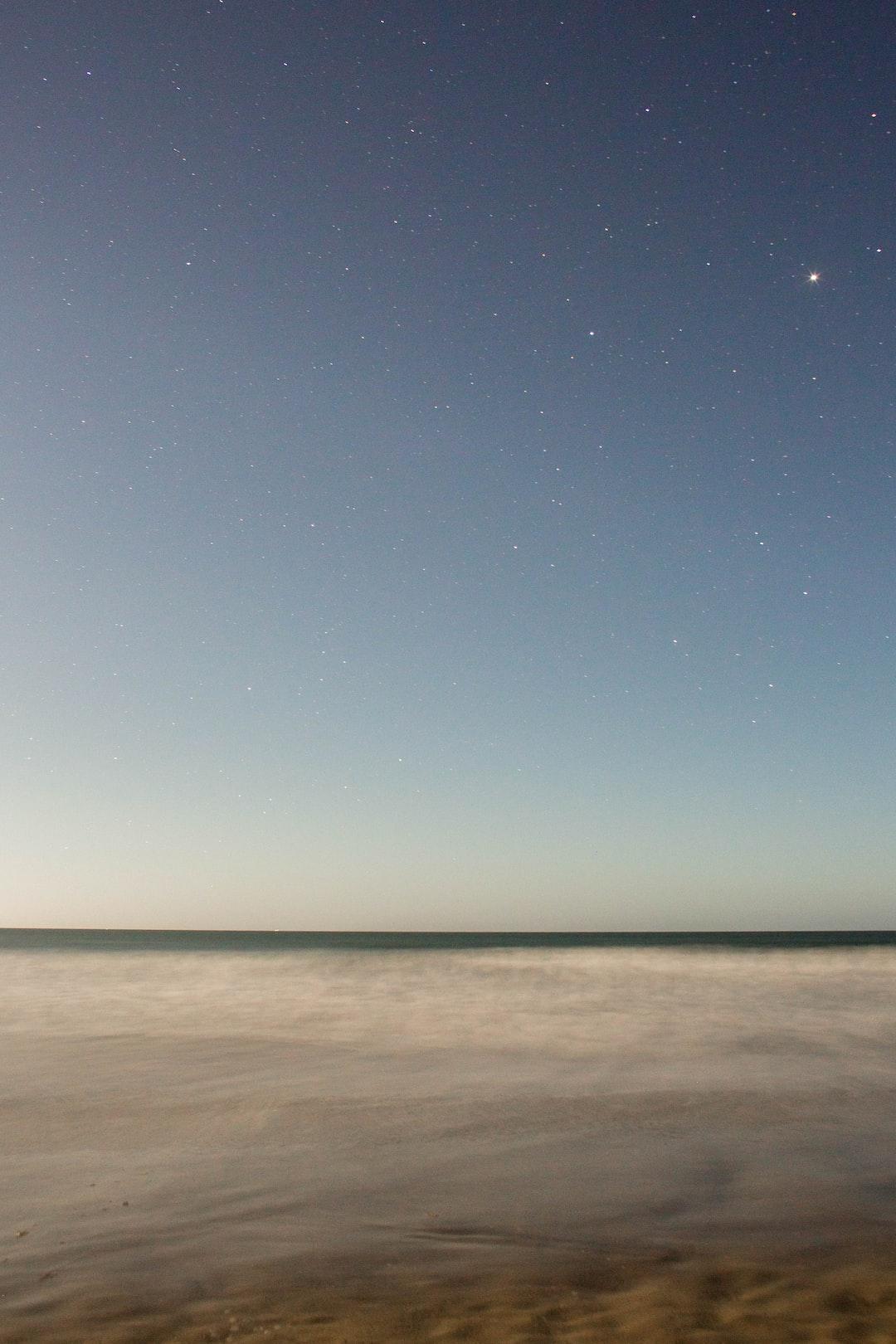 Ocean under starry sky