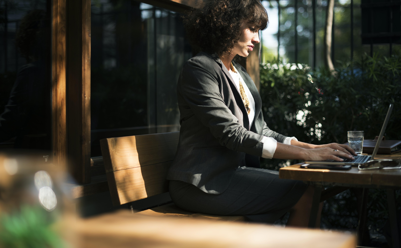 woman typing laptop computer