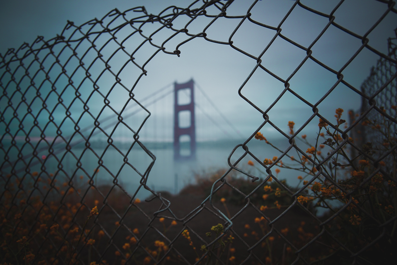 view a fence hole of San Francisco bridge