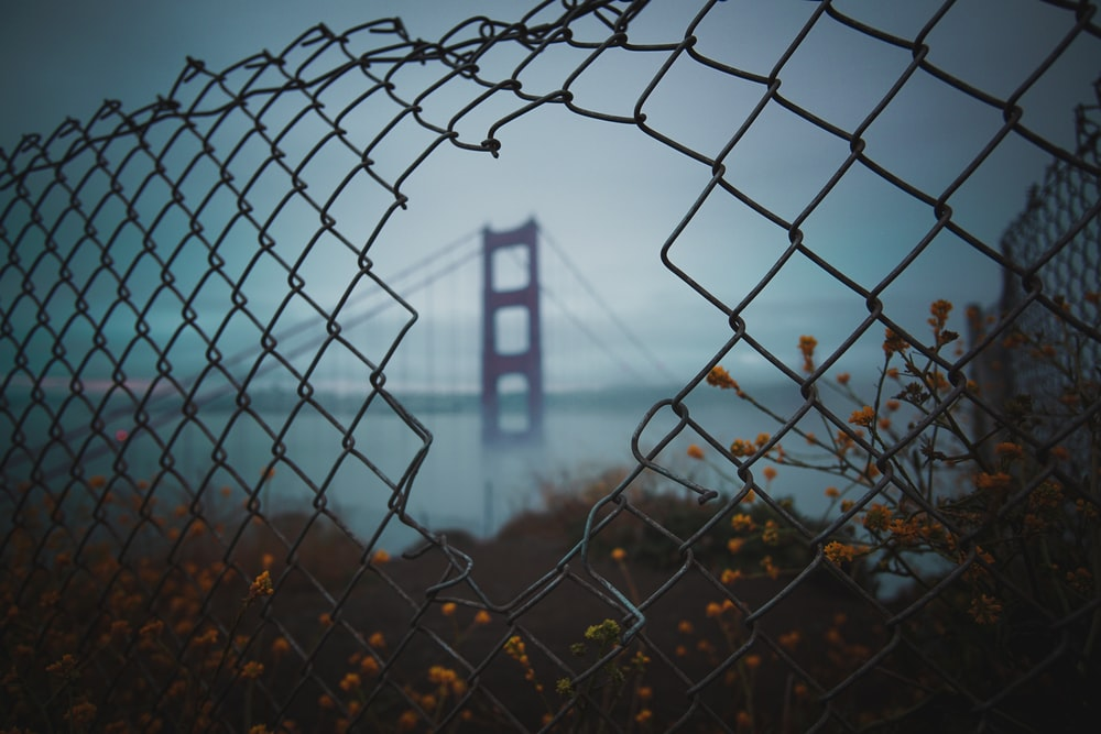 view a fence hole of San Francisco bridge
