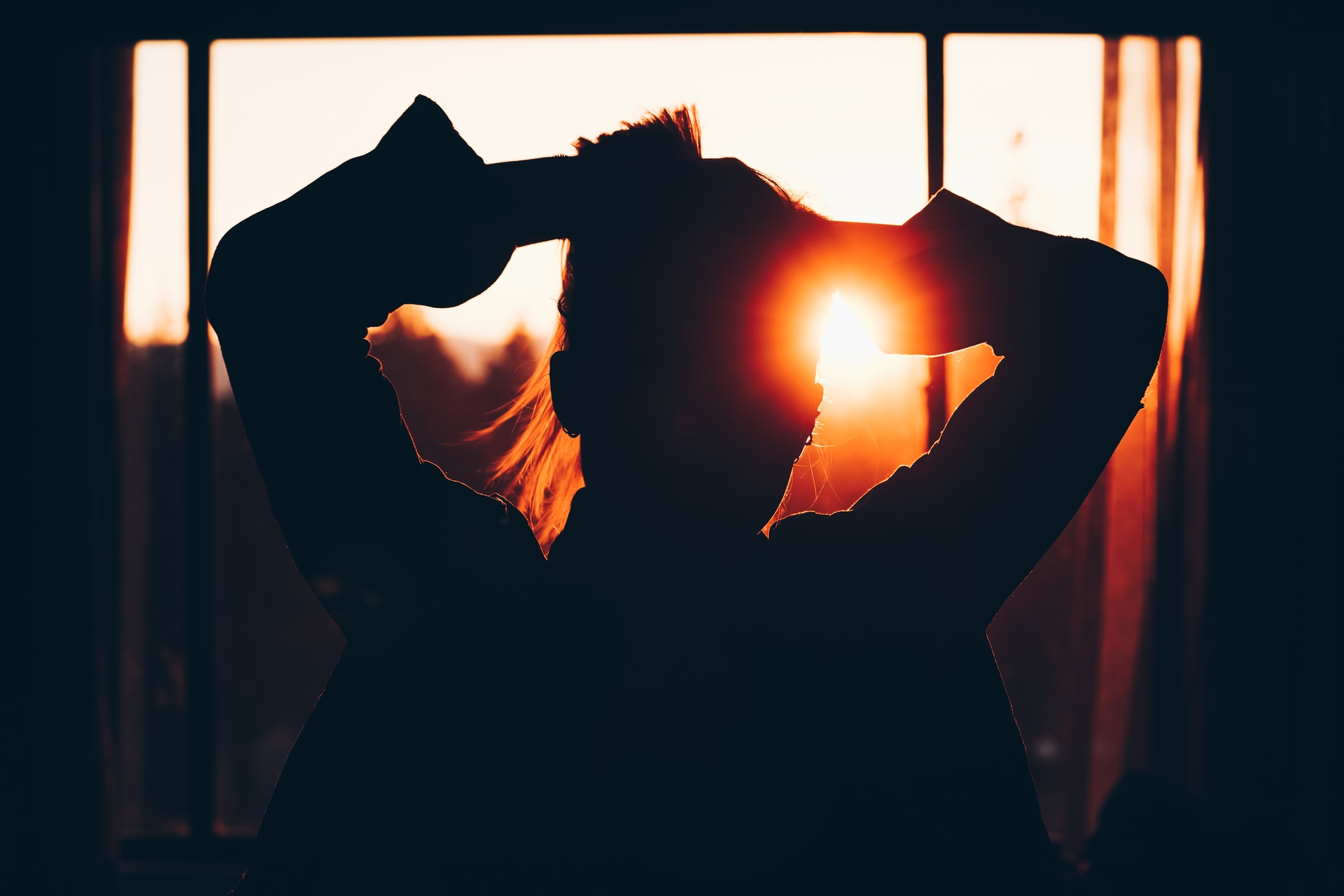 silhouette of woman holding hair