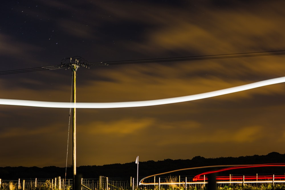 time lapse photography of gray electric post