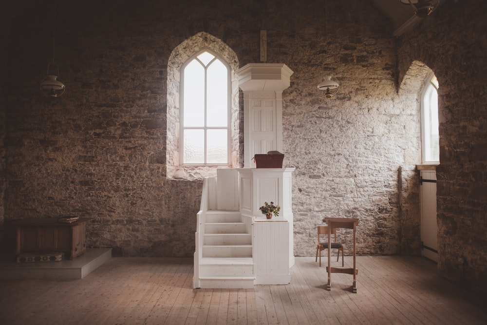 white wooden altar inside church