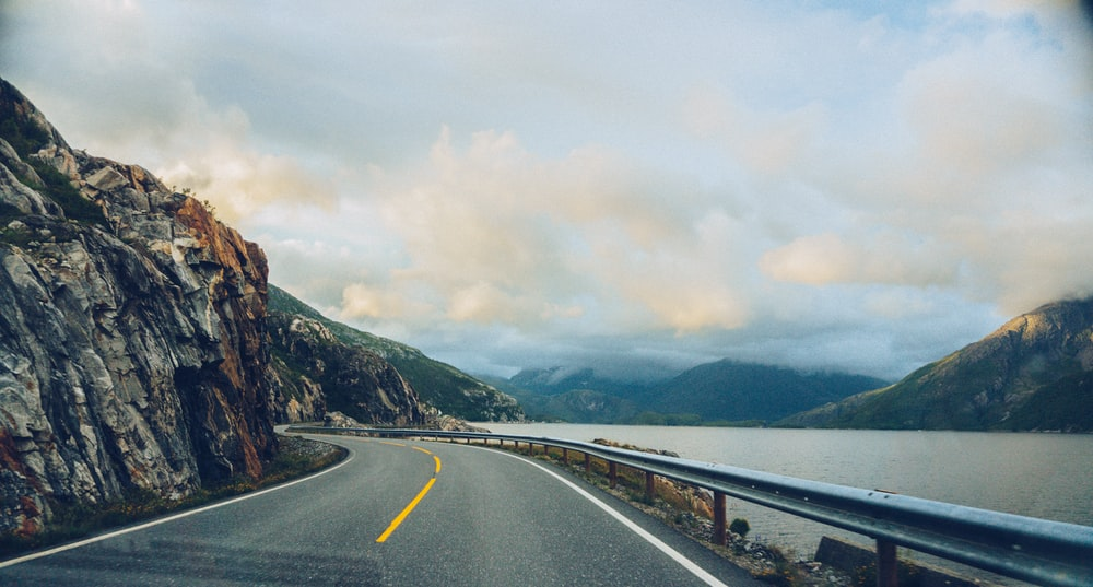 Driving on a mountain highway road near the water