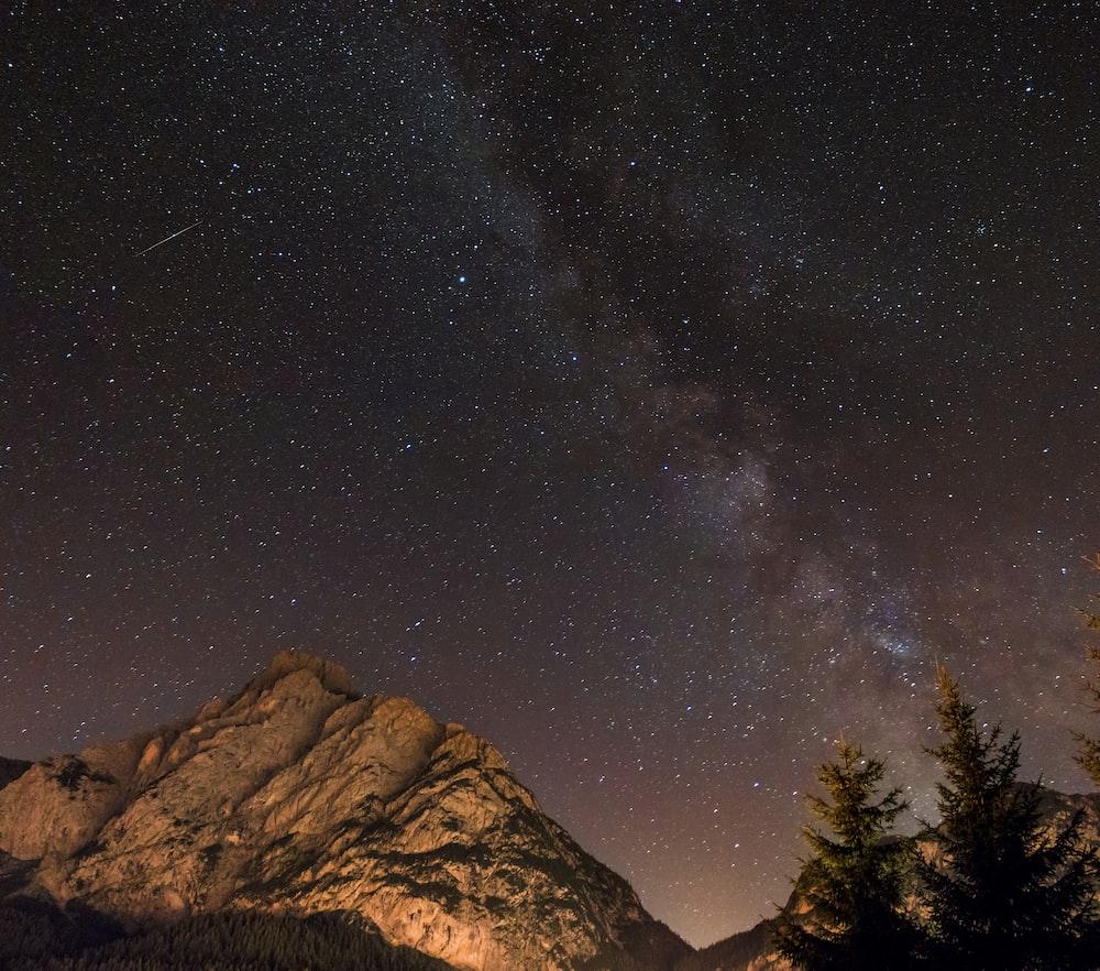 landscape photography of mountain range at night