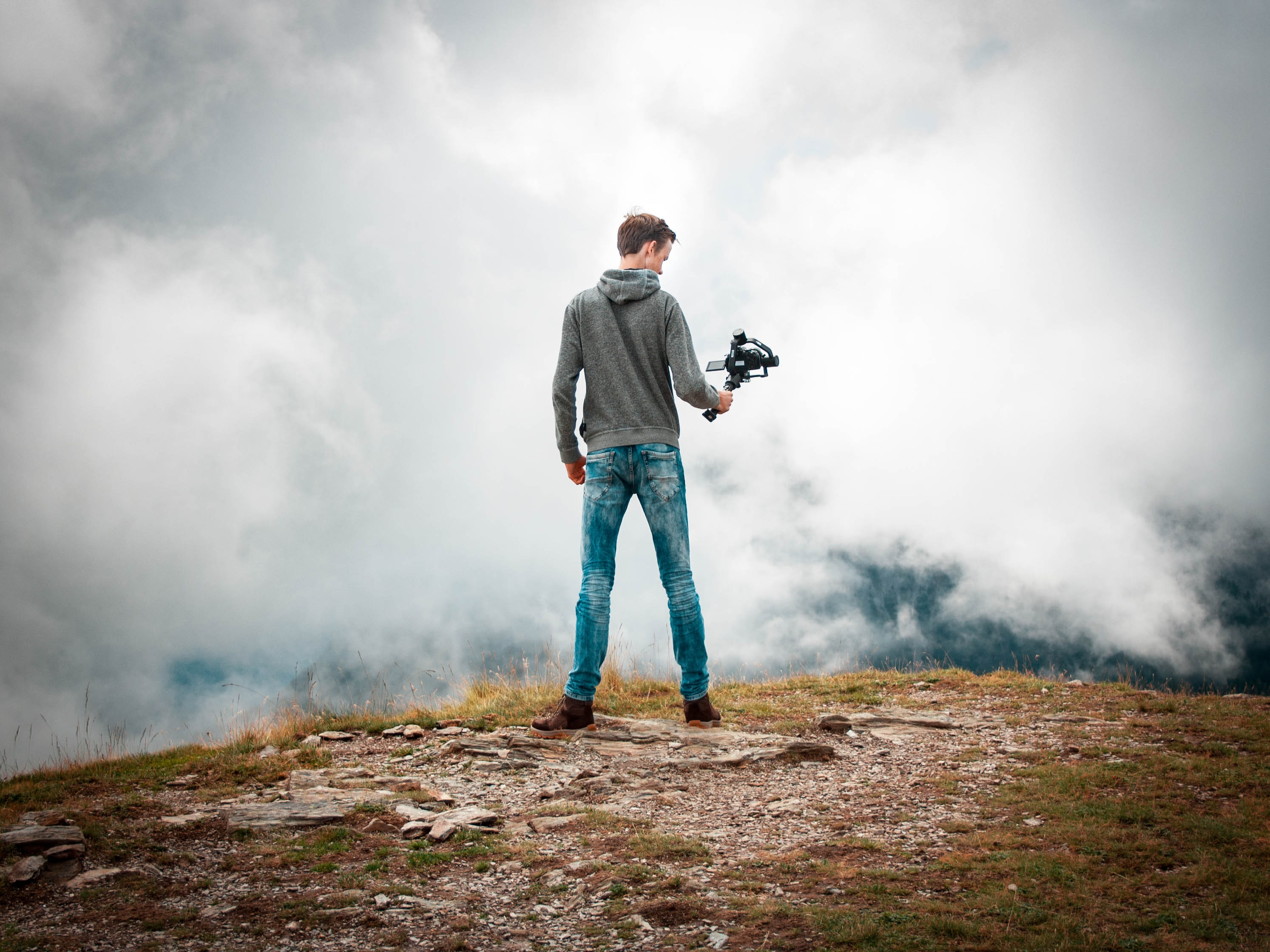 man holding camera with stabilizer while standing
