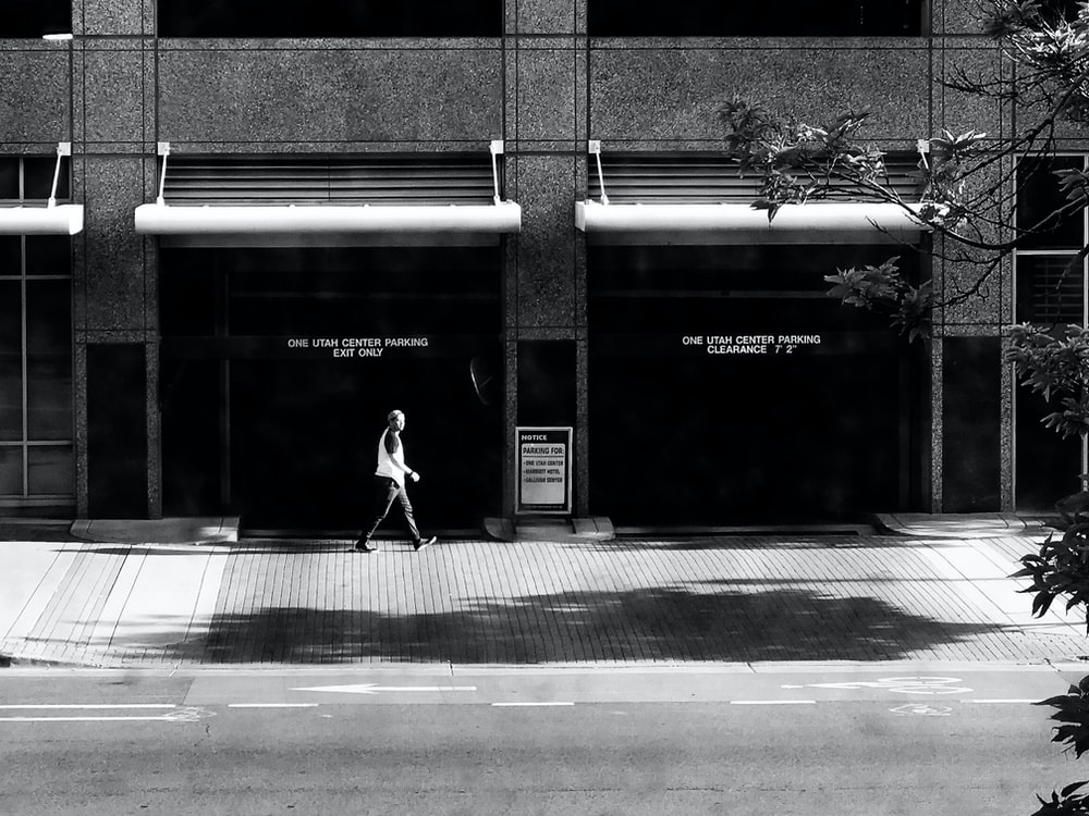person walking in front of building