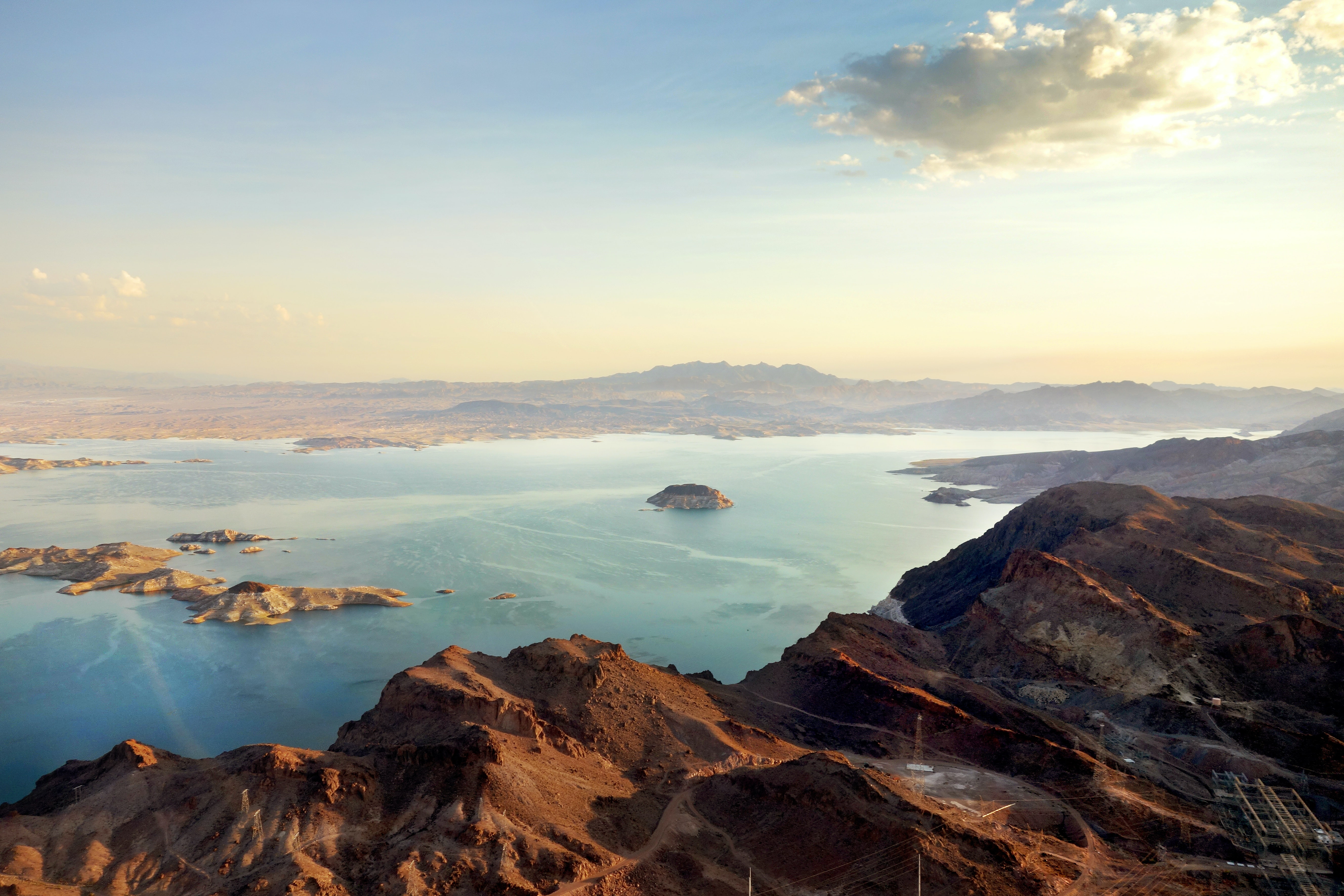 aerial view of body of water surrounded with mountains