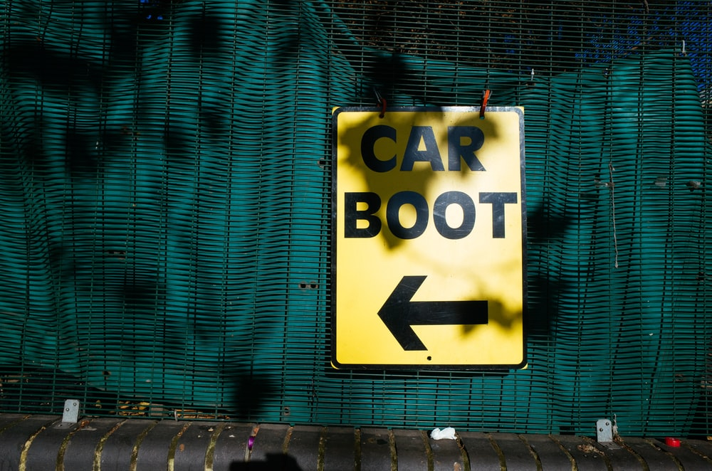 yellow car boot signage