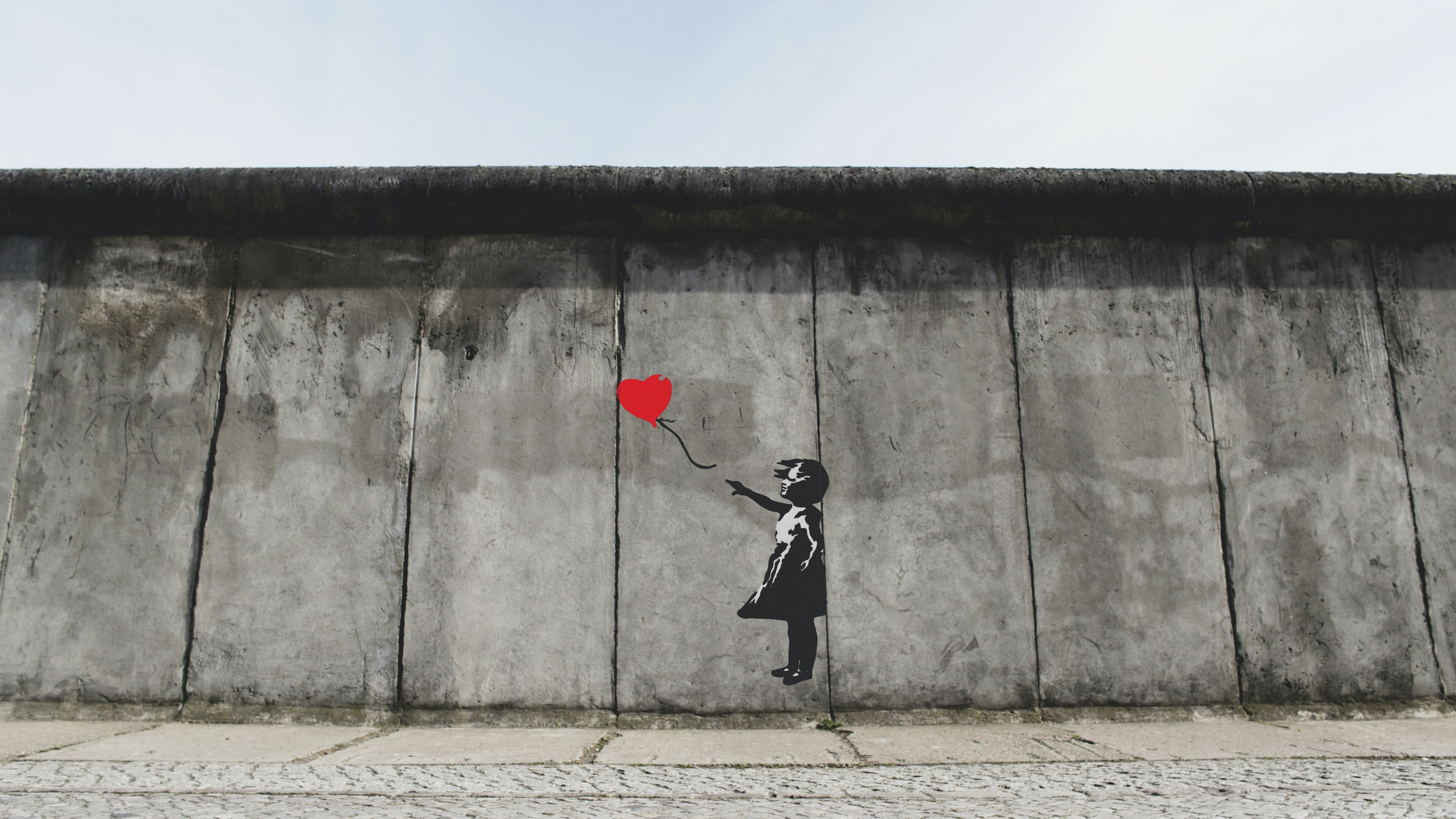 girl playing heart balloon wall artwork