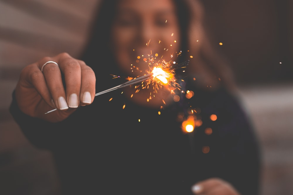 person holding firecracker