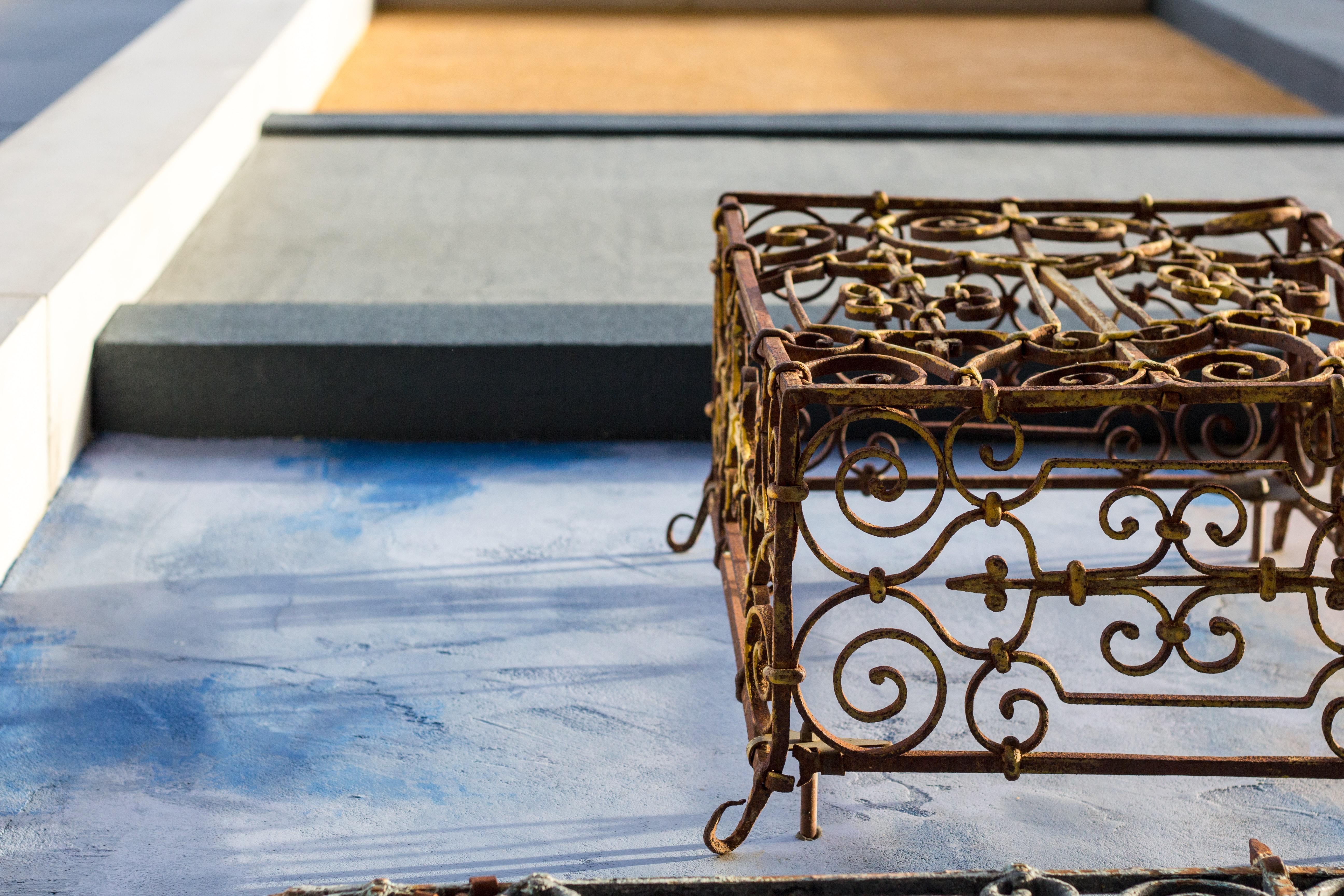 brown metal crate on blue surface