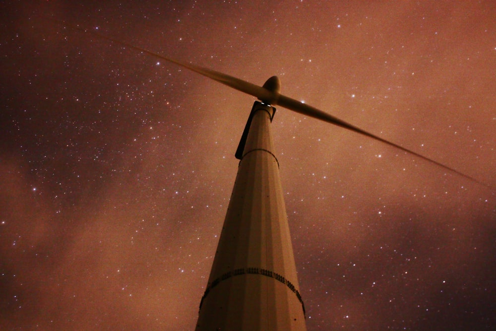 worm's eye view of wind turbine