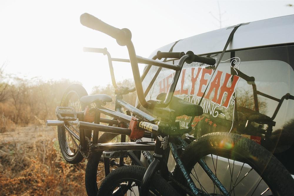 photograph of BMX bikes tied on SUV