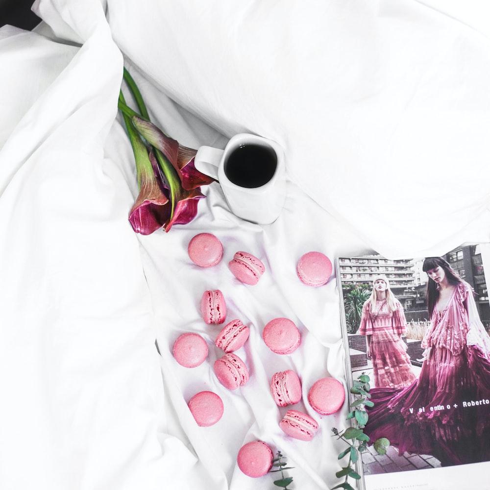 pink munchkins on white comforter