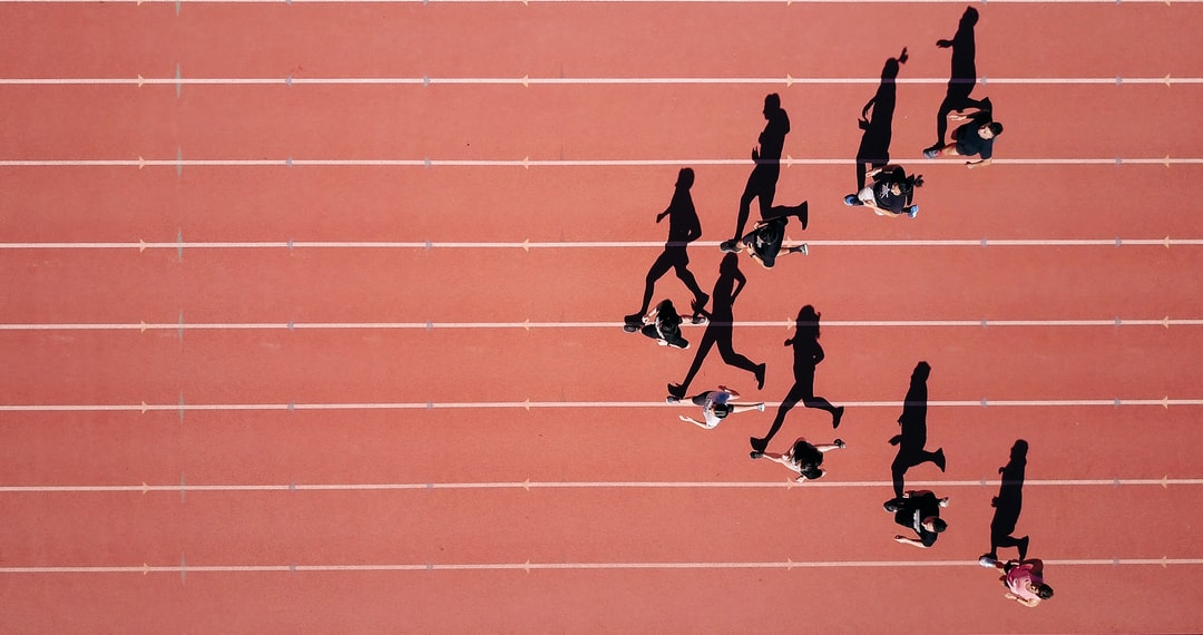 Working on a project for my school's track team on a summer morning. I noticed the sun was perfectly angled to expand the shadows of the runners into full size. I launched my Mavic Pro to 300 ft. and made them run in arrow shape.