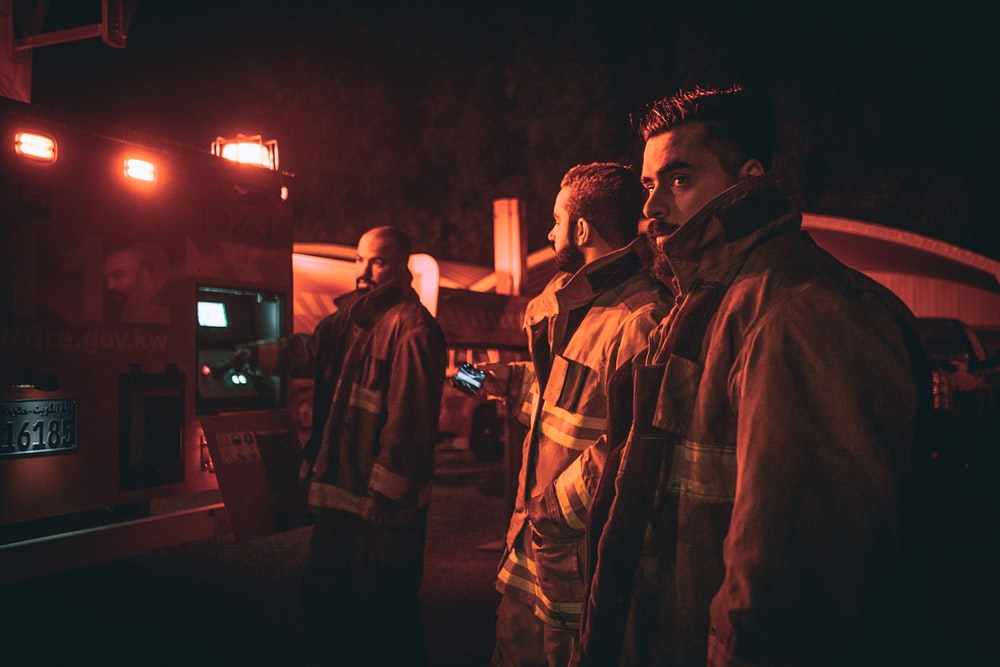three fire fighters looking back