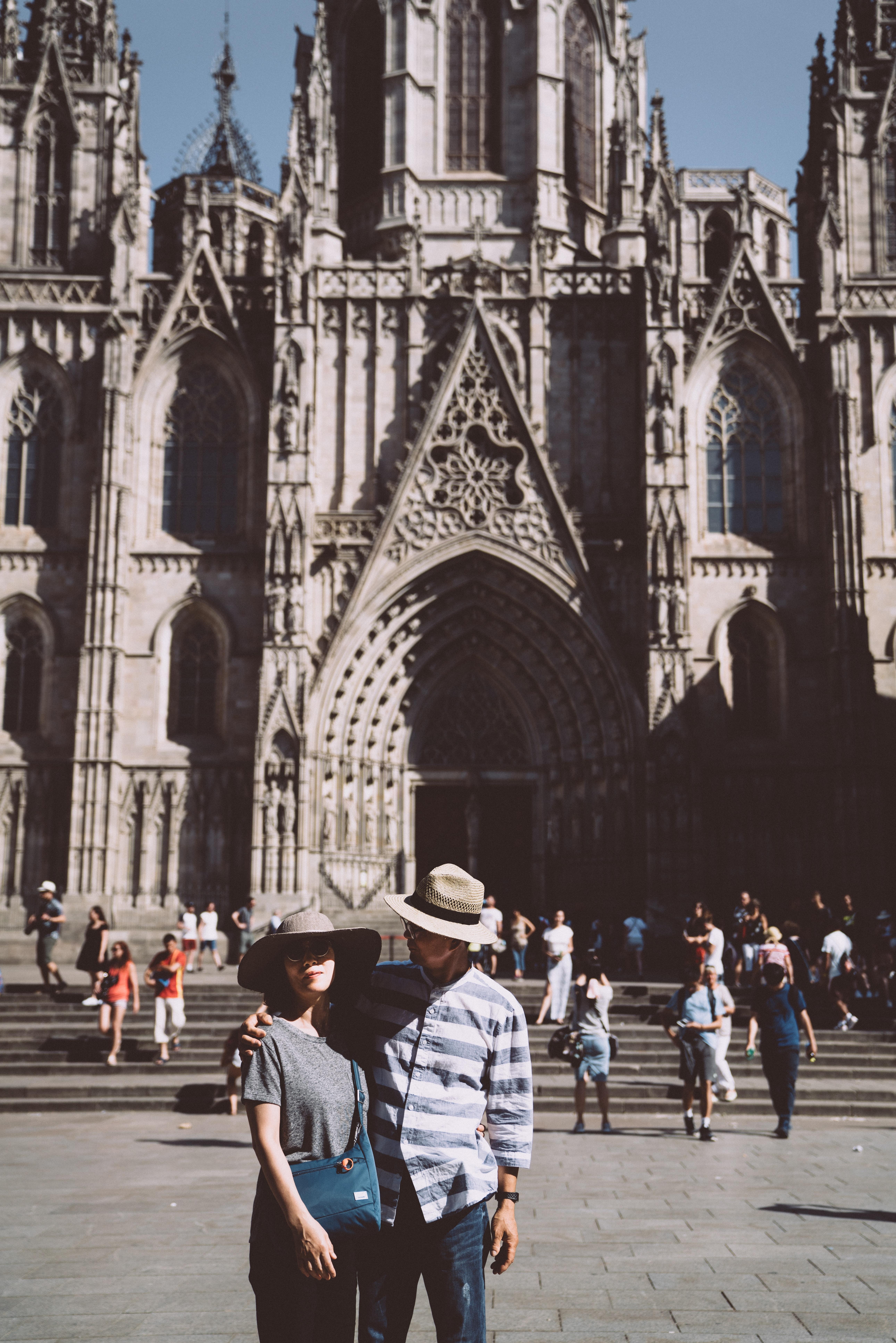 man and woman standing near church