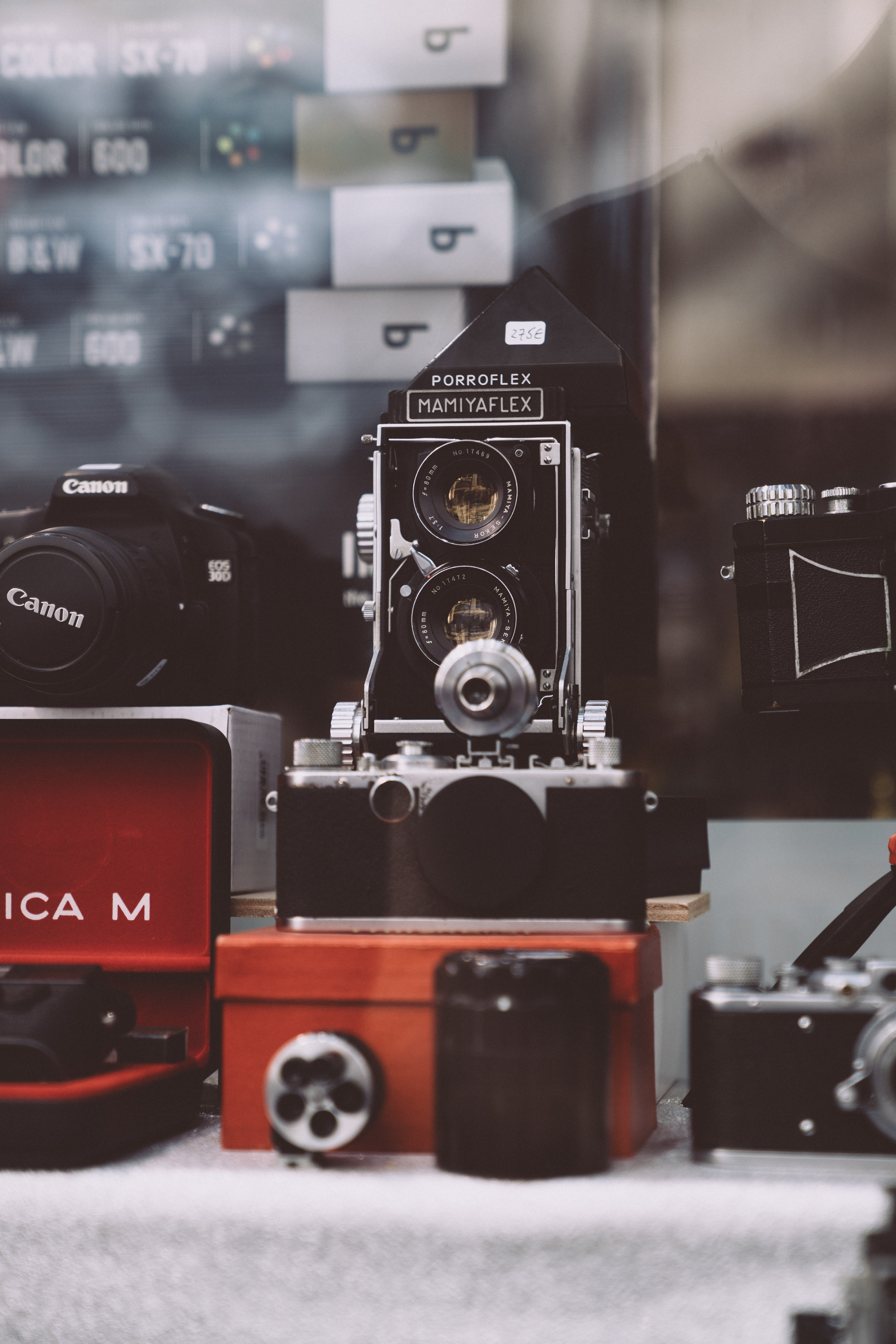 selective focus photography of black and gray twin-lens reflex camera